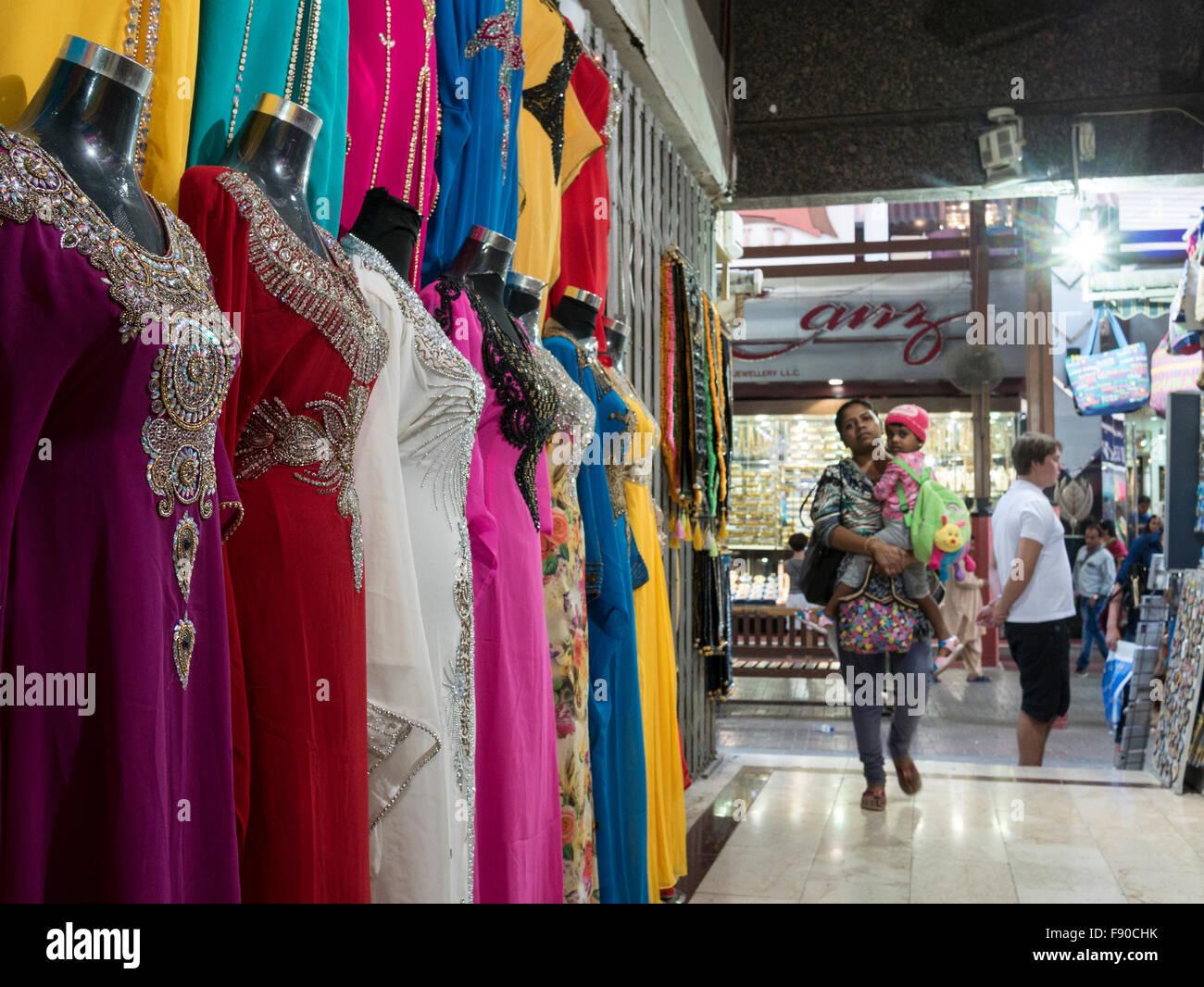 Tourists shopping in textile market (souk) in Dubai heritage