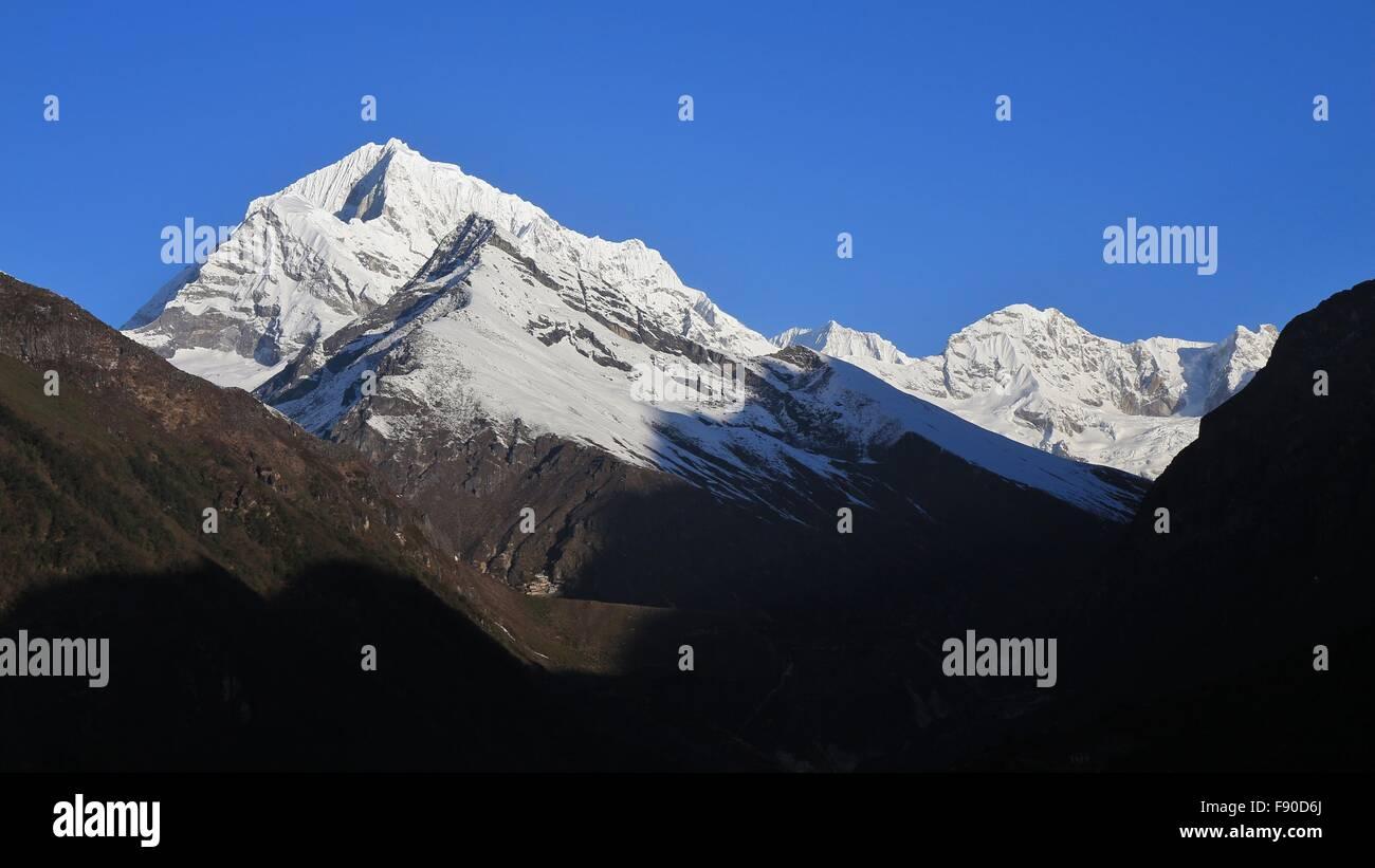 High mountains near Namche Bazaar at sunrise - Stock Image