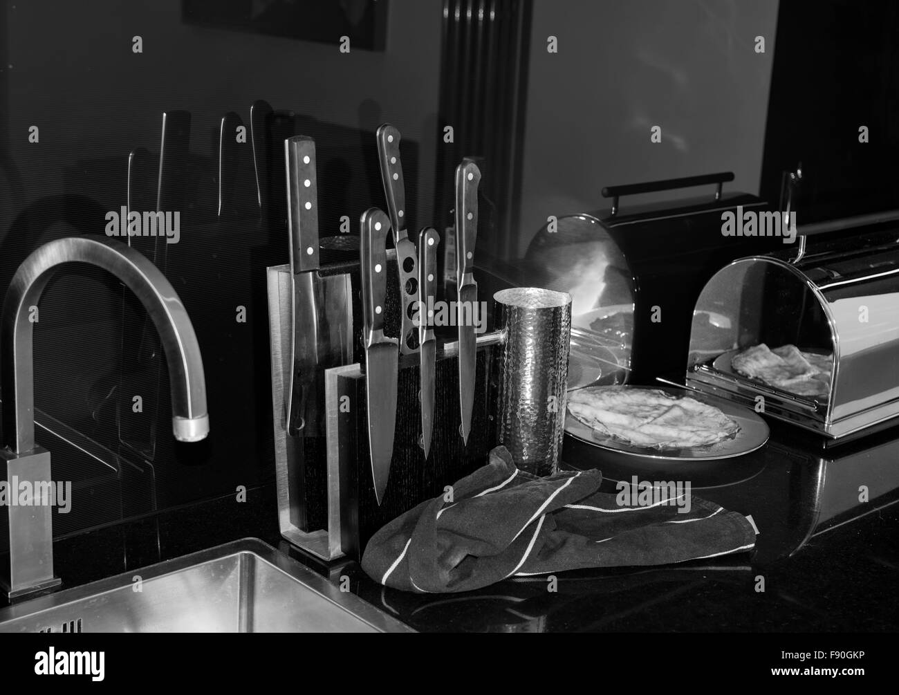 Modern Kitchen With Sink And Kitchen Knives Set In Black And White