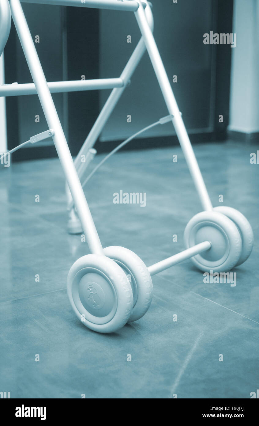 Old person walker frame with wheels in retirement home to help old ...
