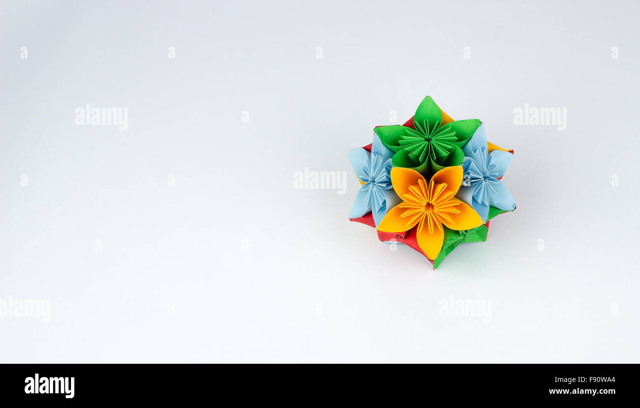Origami flower in multiple colors - Stock Image
