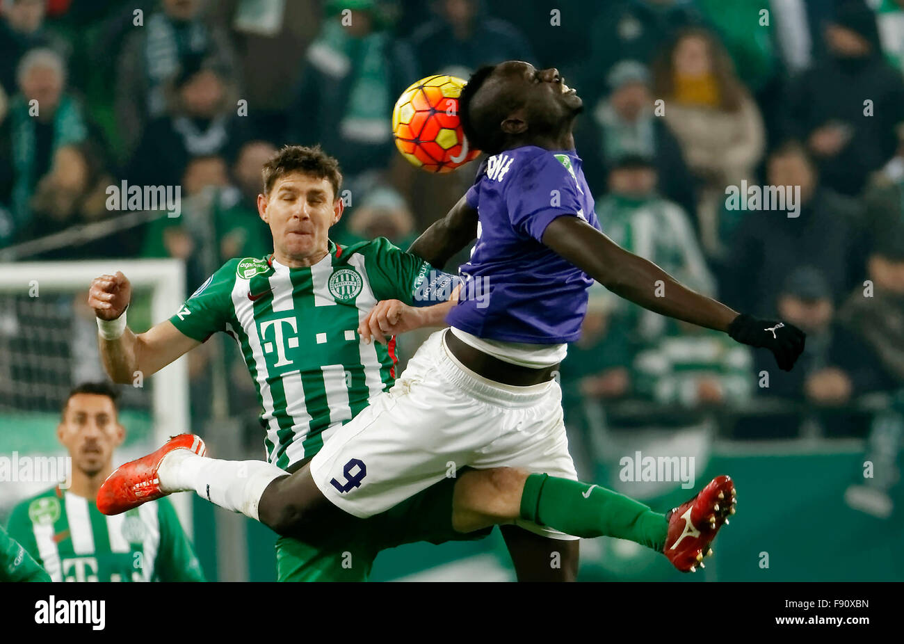 Budapest, Hungary. 12th December, 2015. Air battle between Zoltan Gera of Ferencvaros (l) and Mbaye Diagne of Ujpest - Stock Image