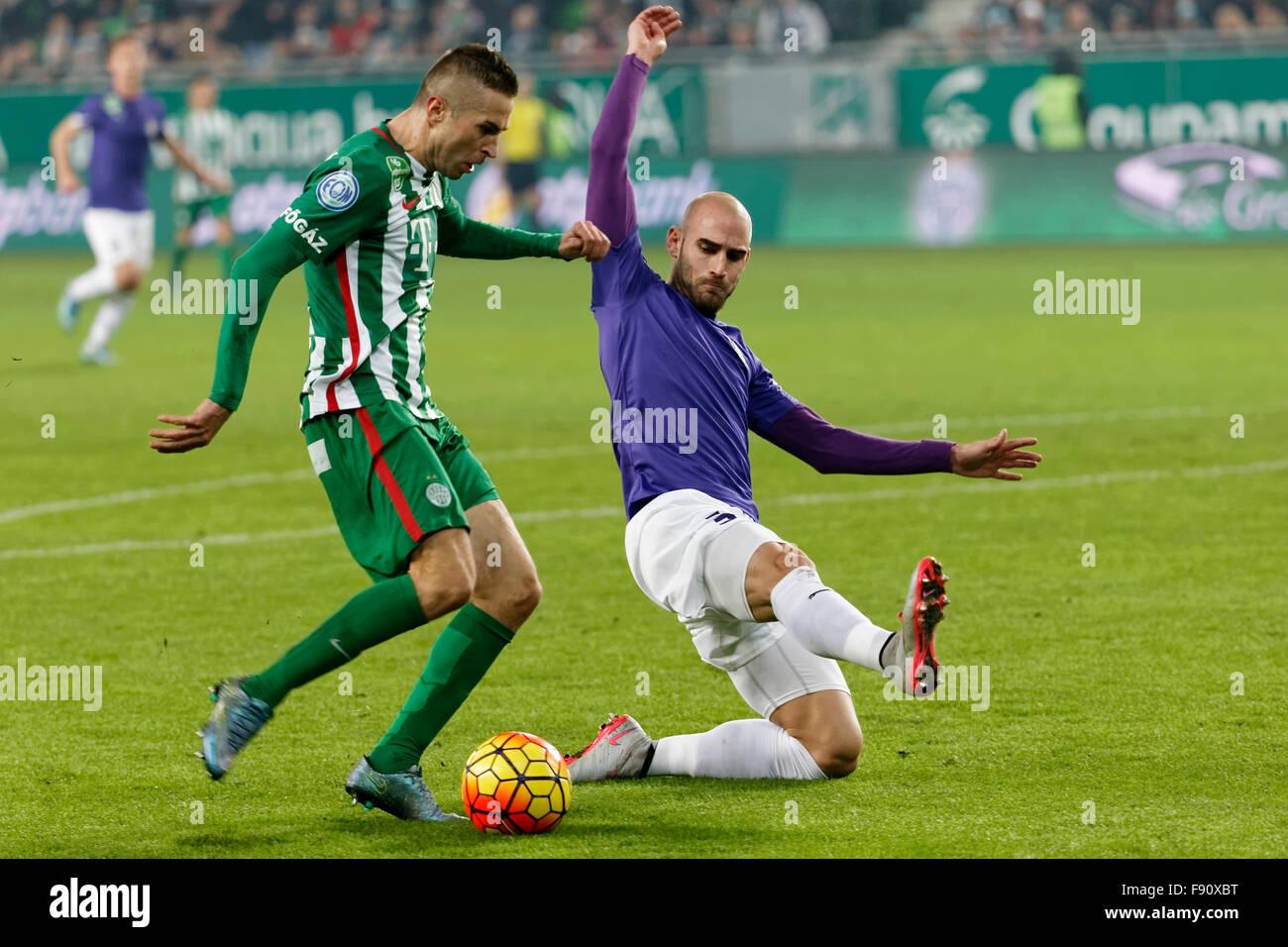 Budapest, Hungary. 12th December, 2015. Stanislav Sestak's shot of Ferencvaros (l) is blocked by Jonathan Heris - Stock Image