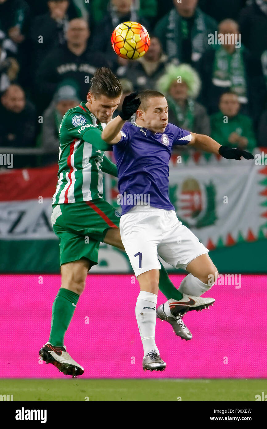 Budapest, Hungary. 12th December, 2015. Air battle between Emir Dilaver of Ferencvaros (l) and Kylian Hazard of - Stock Image
