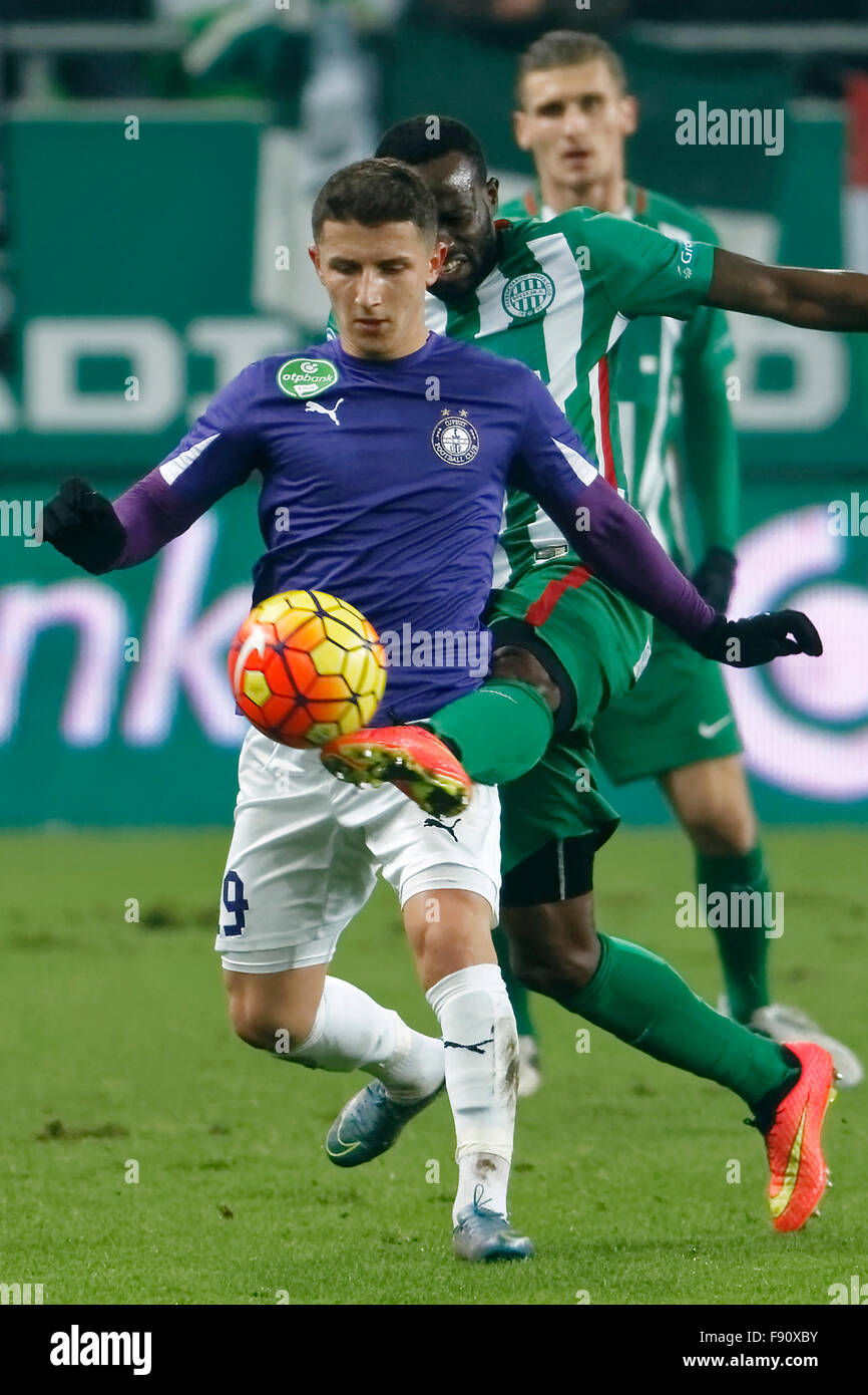 Budapest, Hungary. 12th December, 2015. Roland Lamah of Ferencvaros (r) tries to tackle Enis Bardhi of Ujpest during - Stock Image