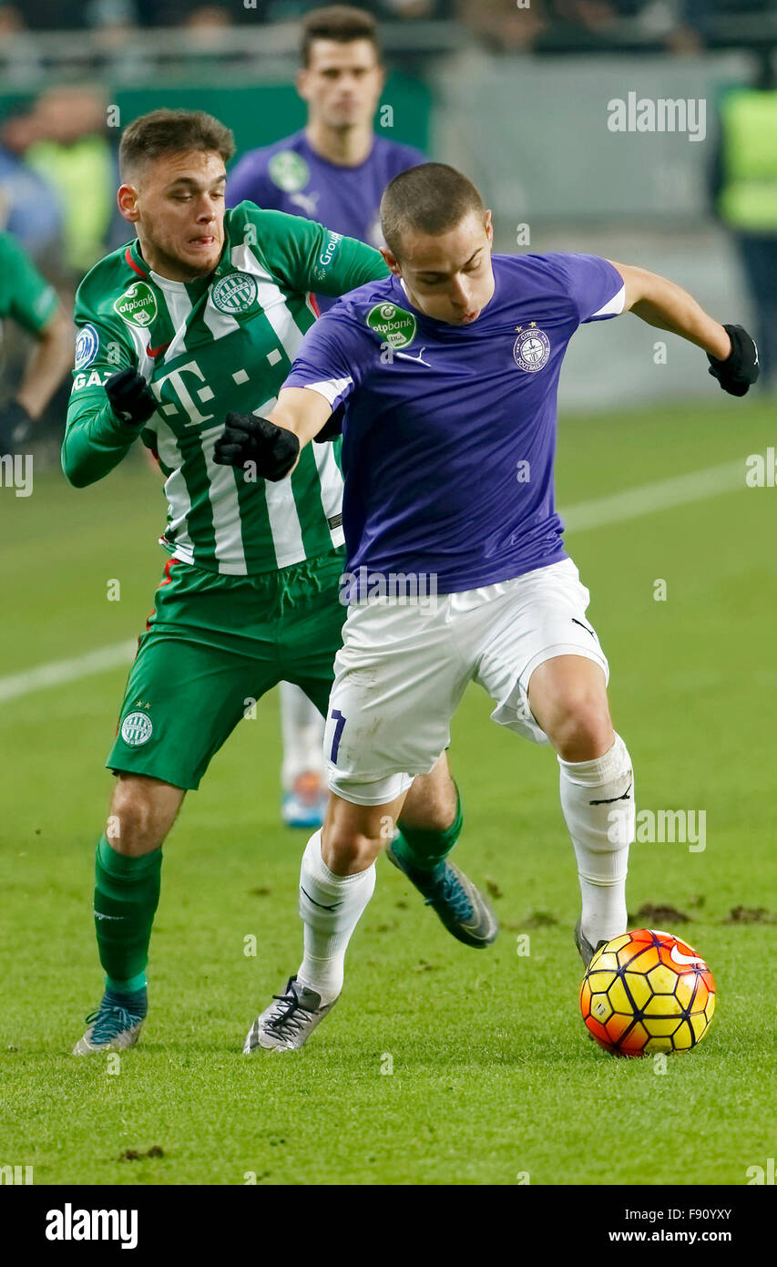 Budapest, Hungary. 12th December, 2015. Andras Rado of Ferencvaros (l) tries to stop Kylian Hazard of Ujpest during - Stock Image