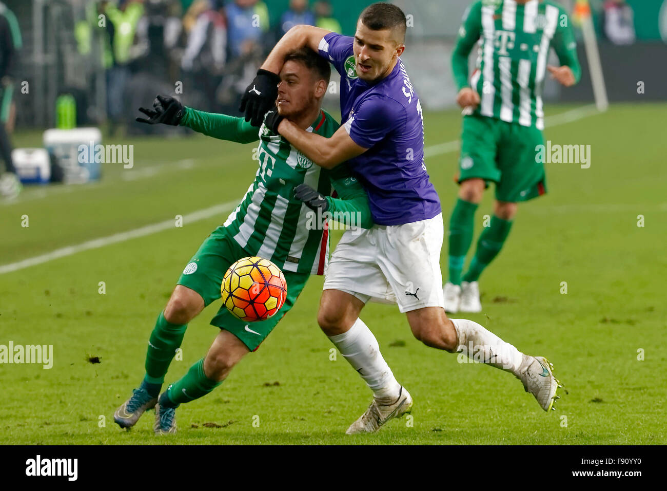 Budapest, Hungary. 12th December, 2015. Andras Rado of Ferencvaros (l) is fouled by Bojan Sankovic of Ujpest during - Stock Image