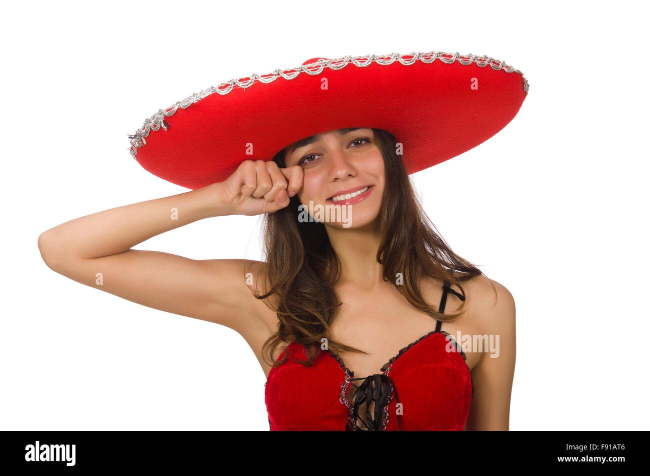 Woman wearing red sombrero isolated on white - Stock Image