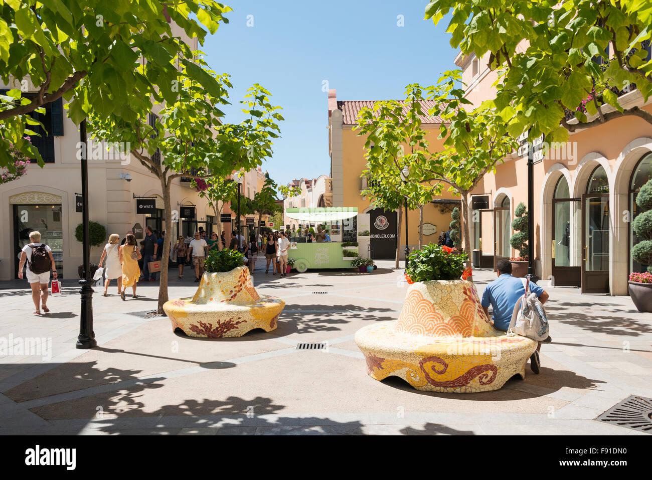 Small square at La Roca Village (Designer Outlet Shopping), La Roca del Vallès, Barcelona, Province of Barcelona, - Stock Image