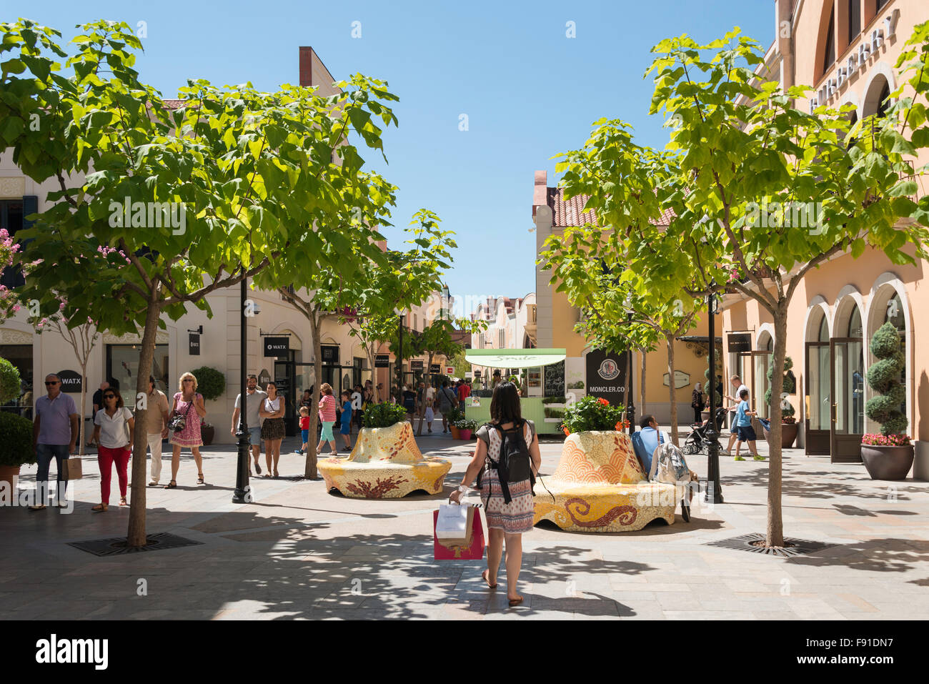 Small square at La Roca Village (Designer Outlet Shopping), La Roca del Vallès, Barcelona, Province of Barcelona, - Stock Image