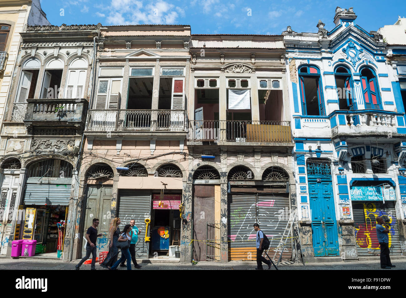 RIO DE JANEIRO, BRAZIL - OCTOBER 22, 2015: Pedestrians pass in front of eclectic architecture in the Santa Teresa - Stock Image