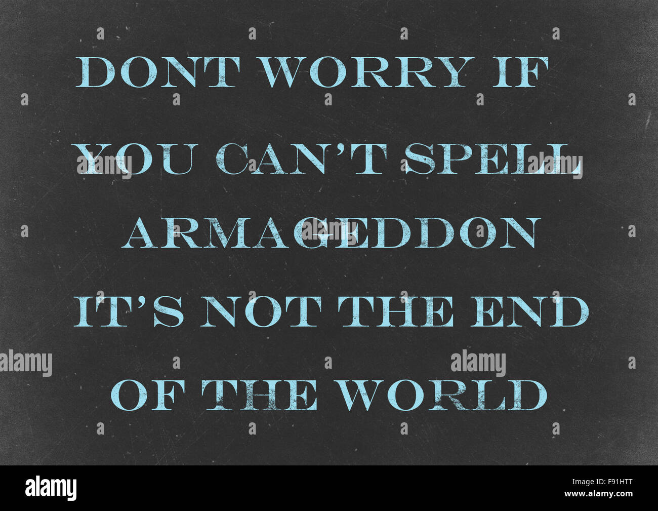 Chalkboard with  'Don't worry if you can't spell Armageddon it's not the end of the world' Hand - Stock Image