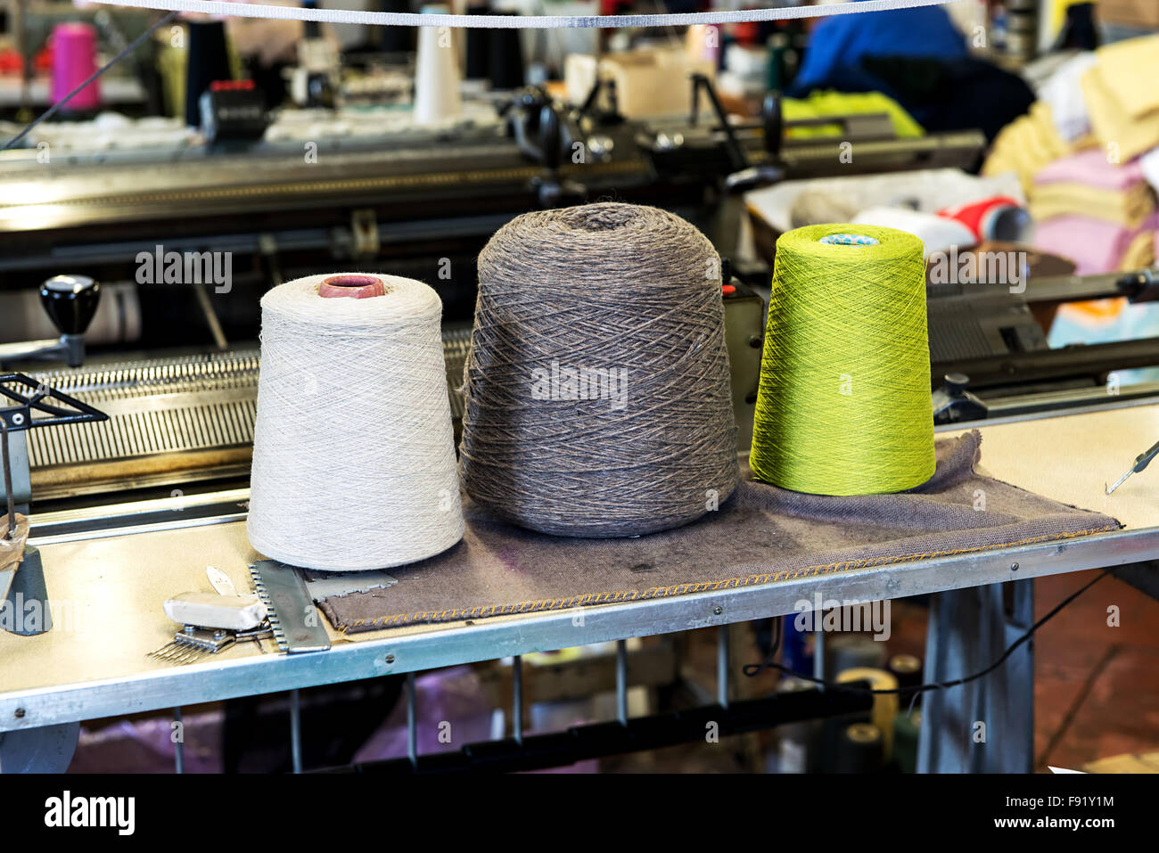 Detail of Three Industrial Size Spools of Cotton Thread in Variety of Colors in Industrial Manufacturing Warehouse - Stock Image