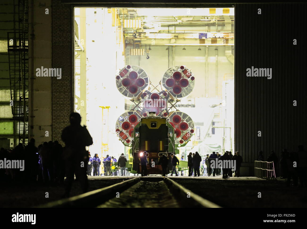 Baikonur, Kazakhstan. 13th Dec, 2015. A Soyuz FG rocket booster with the Soyuz TMA-19M spacecraft being transported - Stock Image