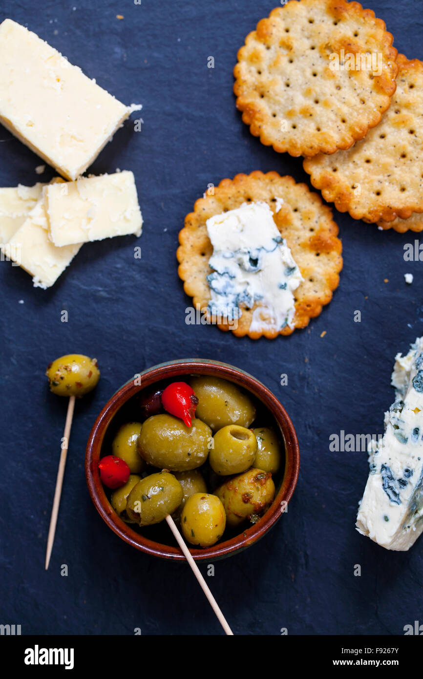 Olives, cheese and biscuits - Stock Image