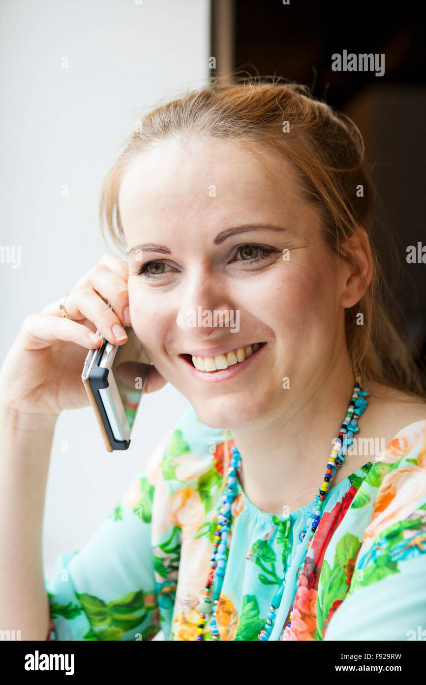 Young woman talking on the mobile phone - Stock Image