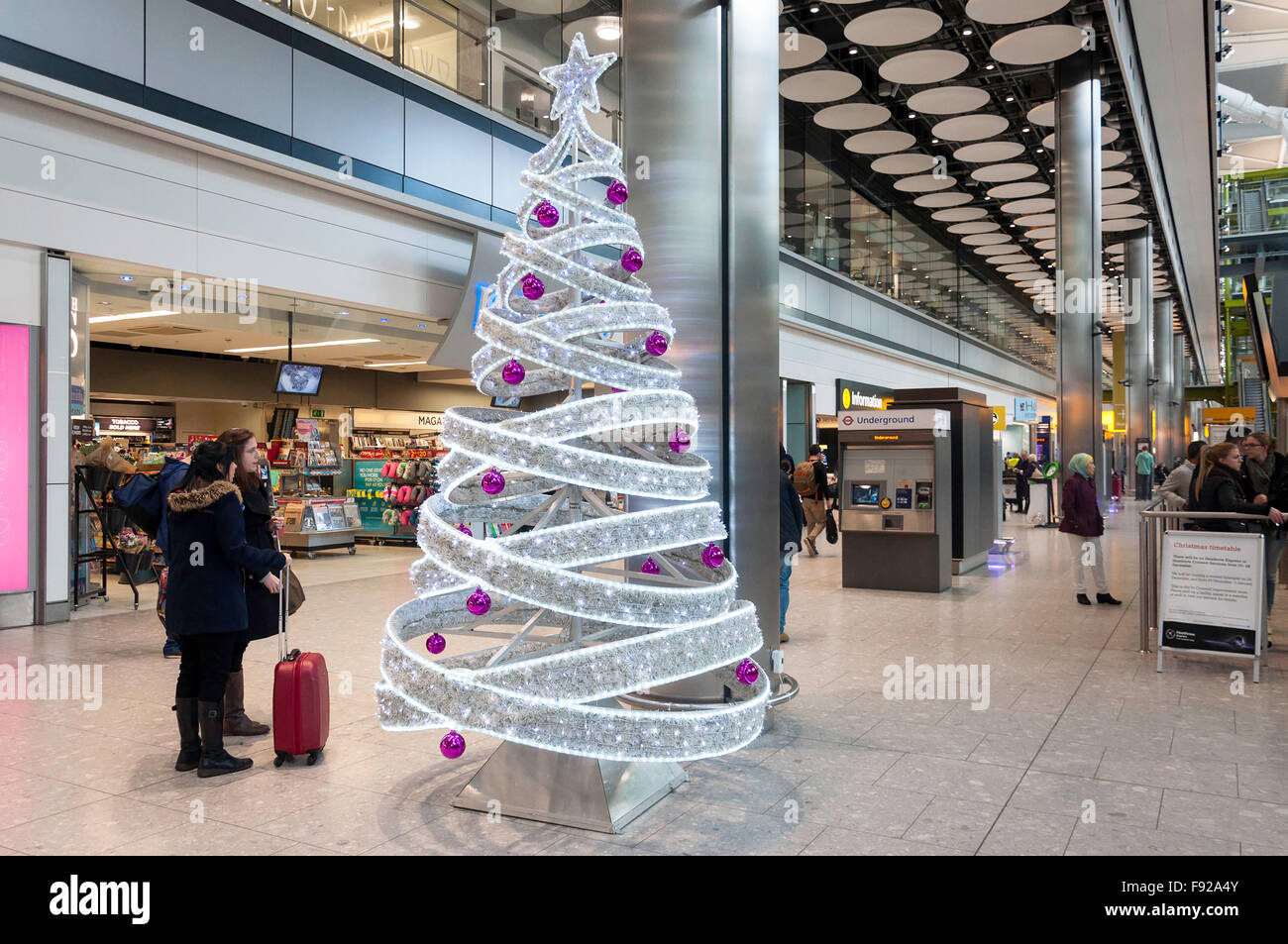 Christmas tree at arrivals level, Terminal 5, Heathrow Airport. Hounslow, Greater London, England, United Kingdom - Stock Image