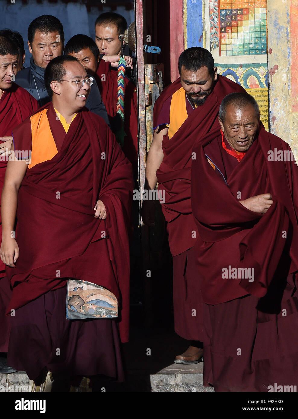 Xigaze, China's Tibet Autonomous Region. 13th Dec, 2015. Bainqen Erdini Qoigyijabu (front L), the 11th Panchen - Stock Image