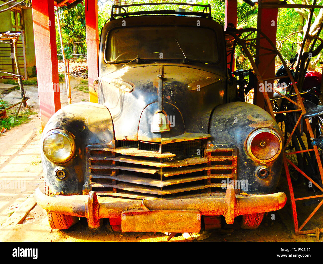Old forgotten car at the backyard - Stock Image