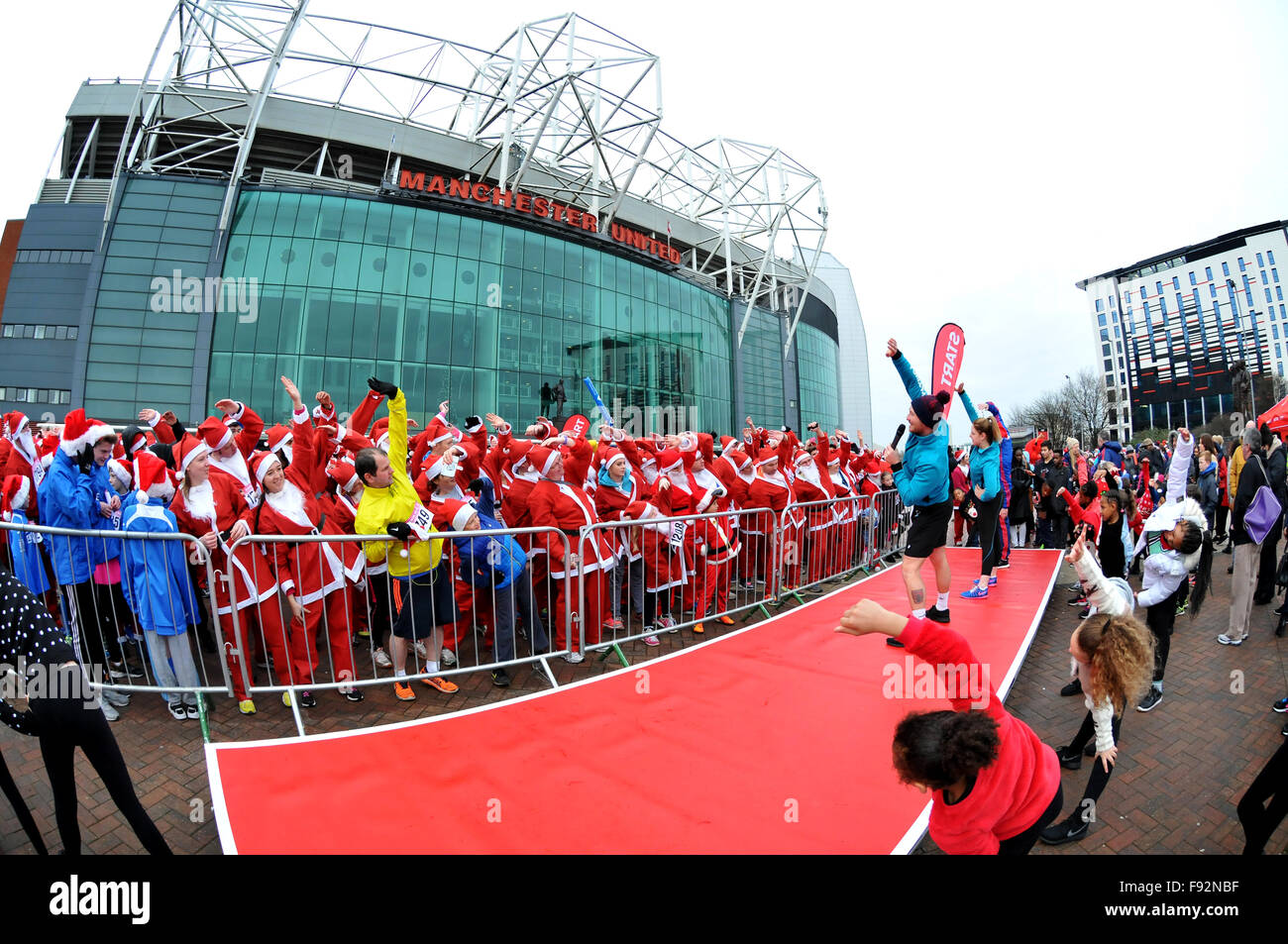 The annual Manchester United Foundation Santa Run, Old Trafford, Manchester. - Stock Image