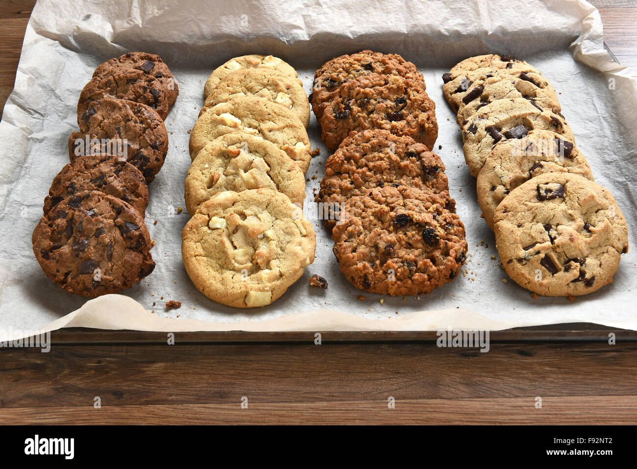 Closeup Of A Tray Of Fresh Baked Cookies, Chocolate Chip, Oatmeal Raisin  Chocolate And White Chocolate Chip Cookies On Baking Sh