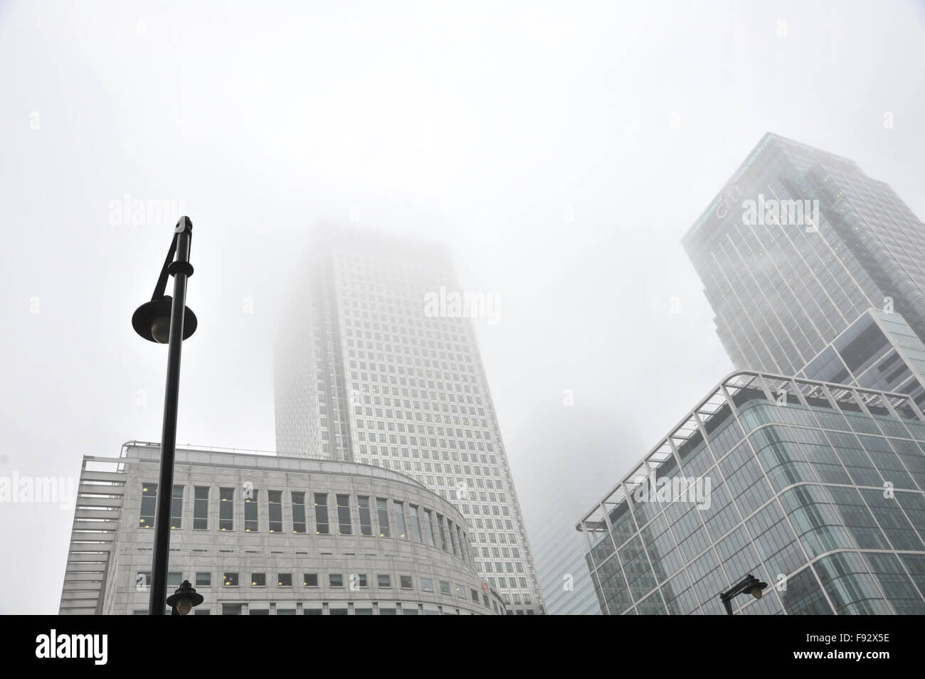 Canary Wharf, London, UK. 13th December 2015. UK Weather: Misty, murky weather in Canary Wharf Credit:  Matthew - Stock Image