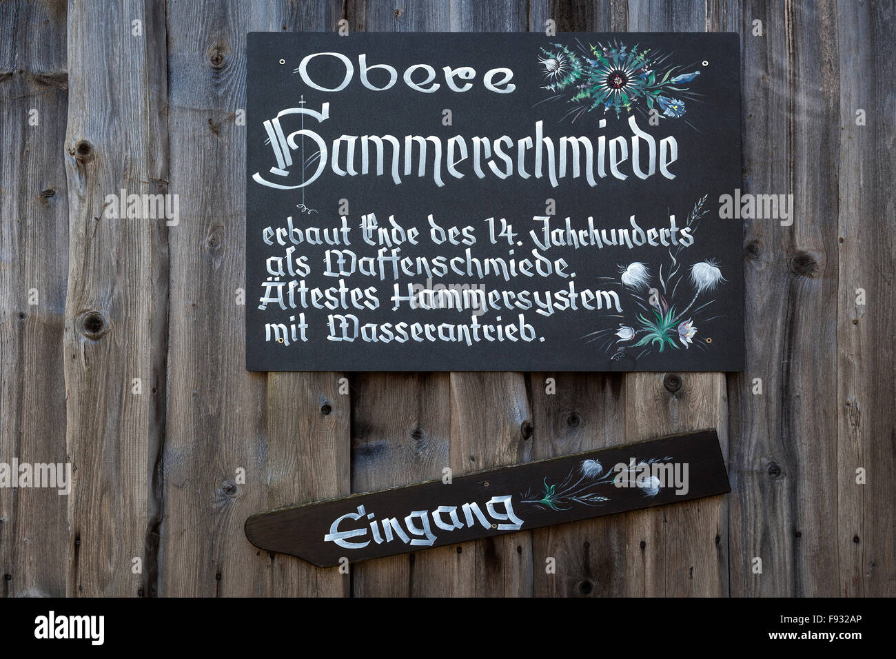 Sign on an old forge, Obere Hammerschmiede, Bad Oberdorf in Bad Hindelang, Allgäu, Bavaria, Germany - Stock Image