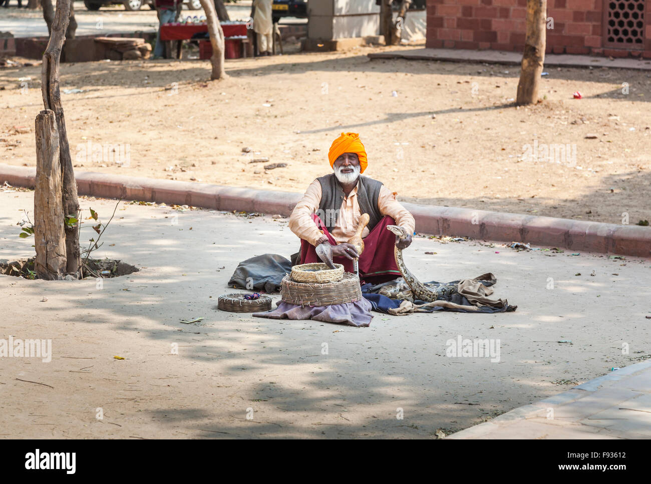 Roadside snake charmer with cobra and python, Fatehpur Sikri, a city in the Agra District of Uttar Pradesh, India Stock Photo