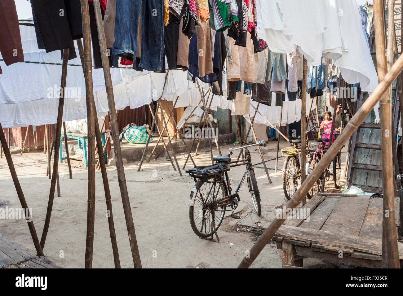 A bicycle and clothes drying at Dhobi Ghat, a large open air laundromat in Mumbai, India - Stock Image
