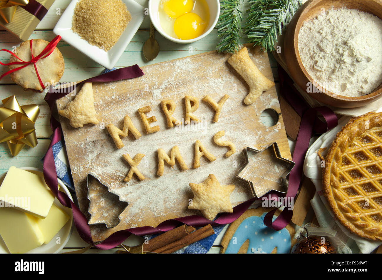 Christmas Baking Background With Merry Xmas Made From Cookies On A