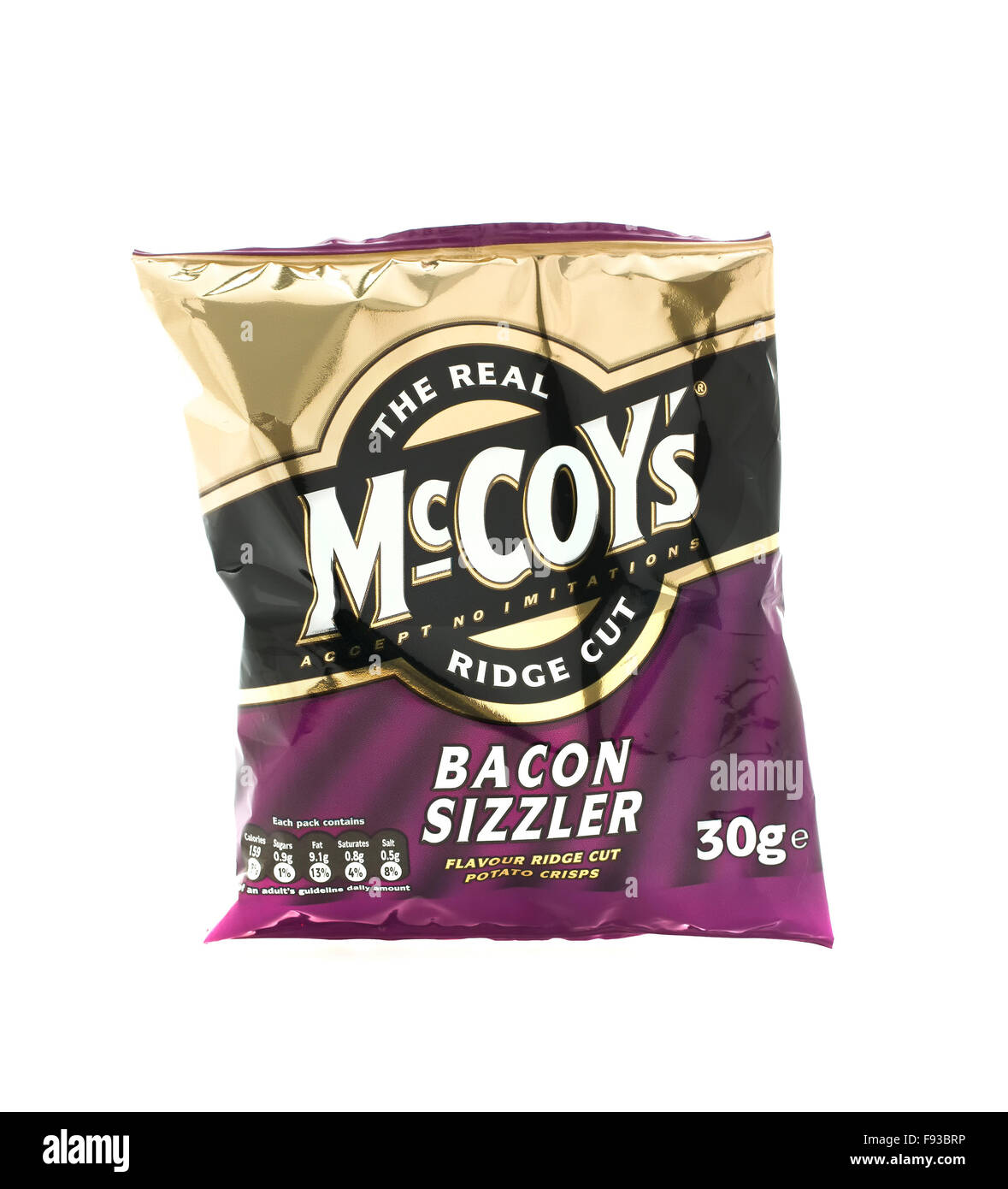 Bacon Sizzler McCoy Ridge Cut Crisps on a white background, McCoy's are made by KP Snacks in the UK - Stock Image