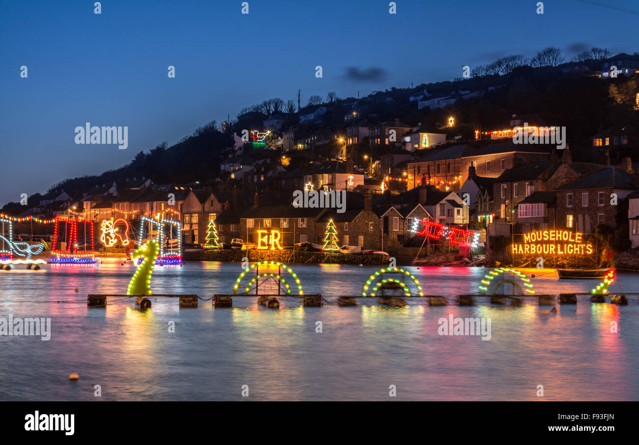 Mousehole, Cornwall, UK. 13th December 2015. This weekend saw the annual turn on of the harbour lights at Mousehole. - Stock Image