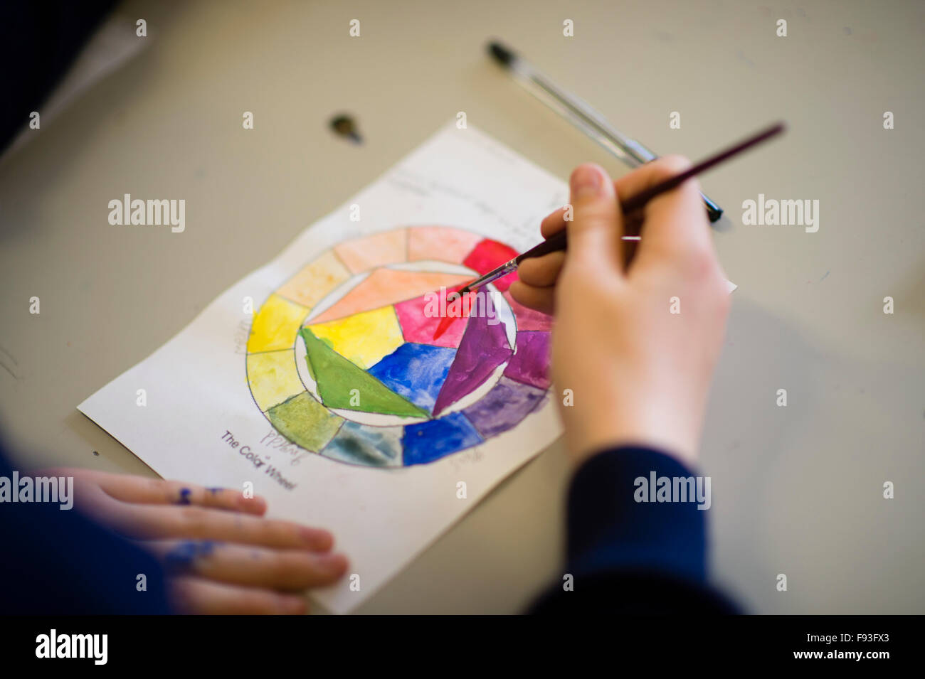 Secondary education Wales UK: pupils painting in an art class lesson - Stock Image