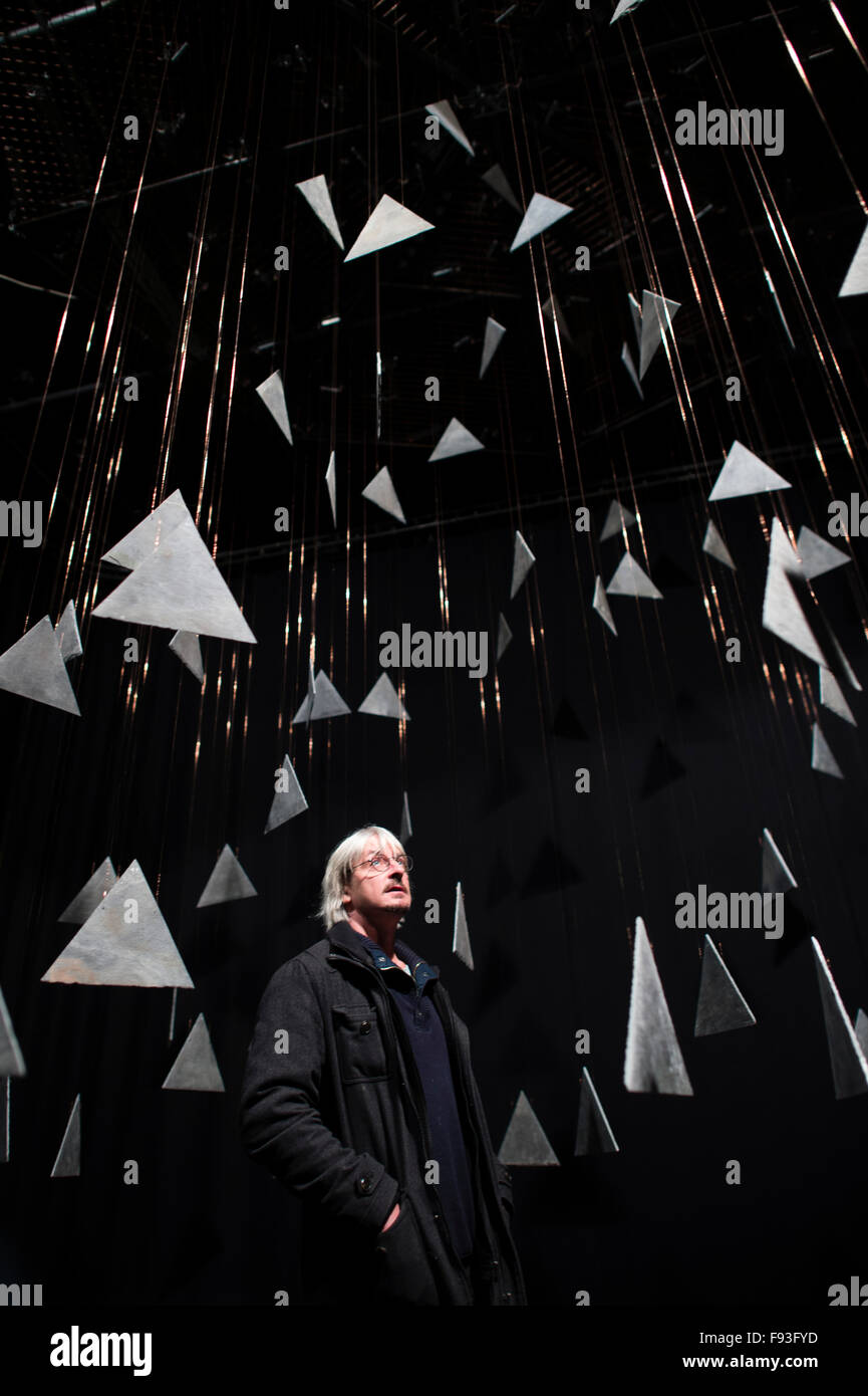 The Fractal Clock, created by artist and performer Richard Downing (pictured standing amongst the hanging slates) - Stock Image