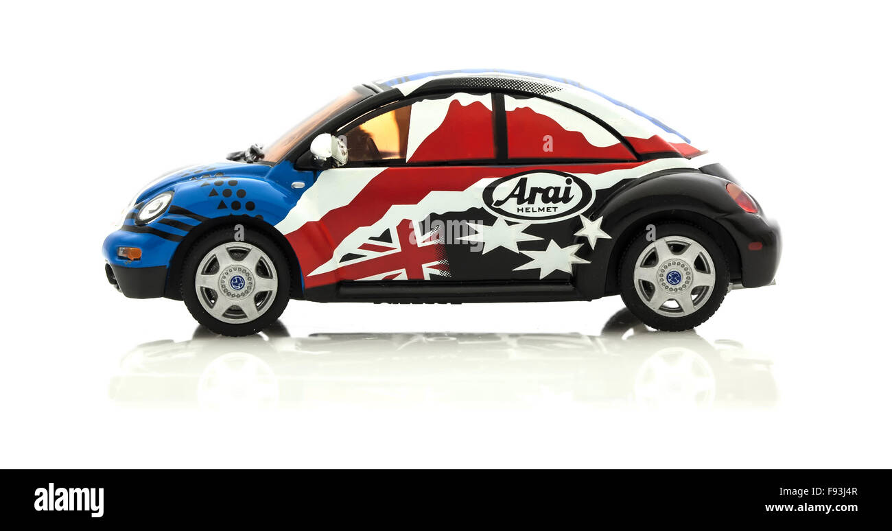 VW Beetle in Race Trim  Die cast model in Arai colours and Logo  on a white background. - Stock Image