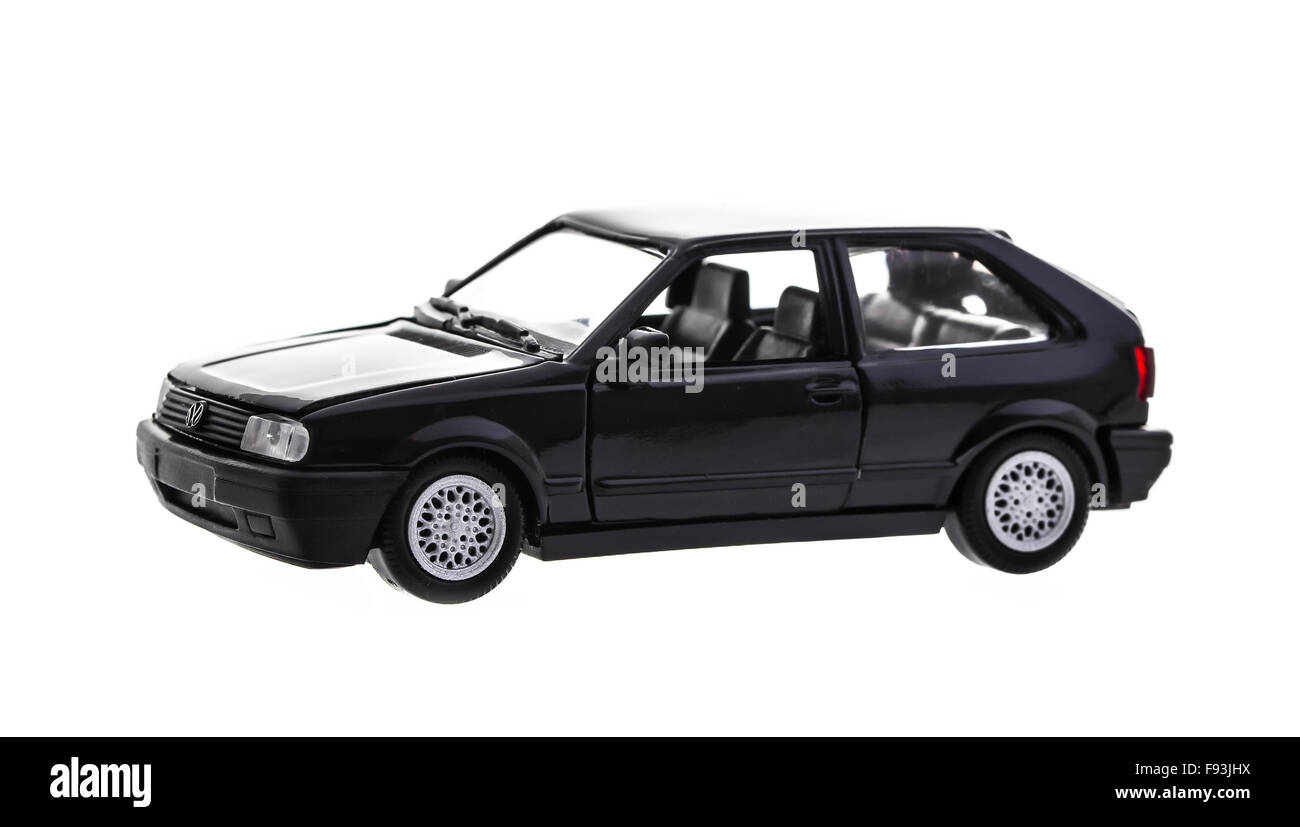 Scale Model of a Black VW Polo on a white background - Stock Image