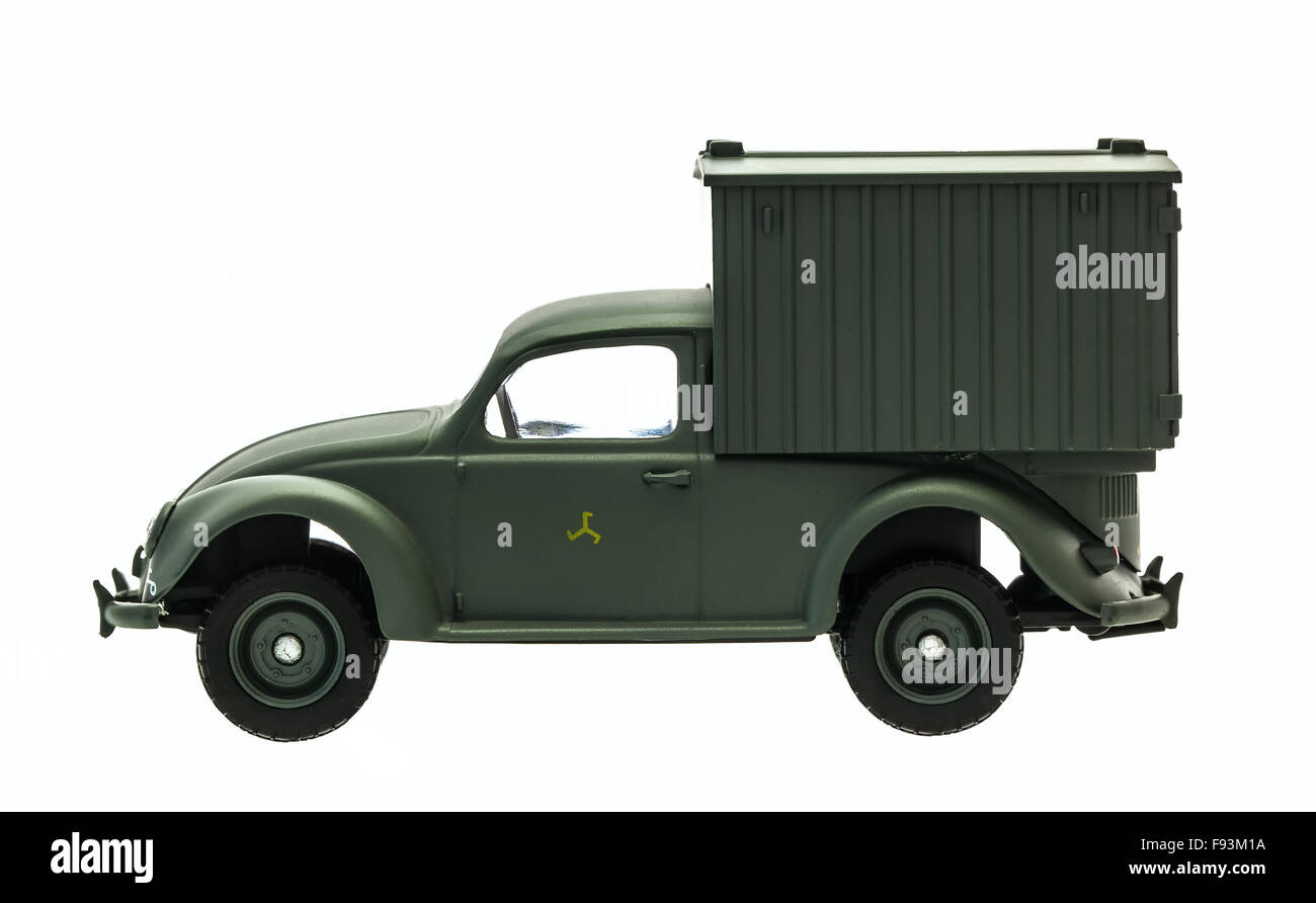 Old Green VW Beetle Army Van Model on a white background - Stock Image