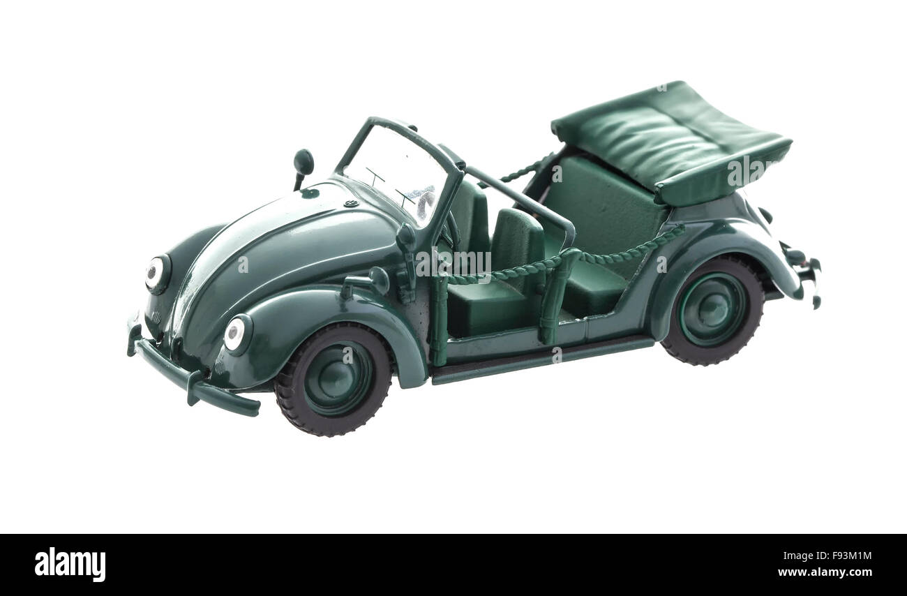 Old Green VW Beetle Model on a white background - Stock Image
