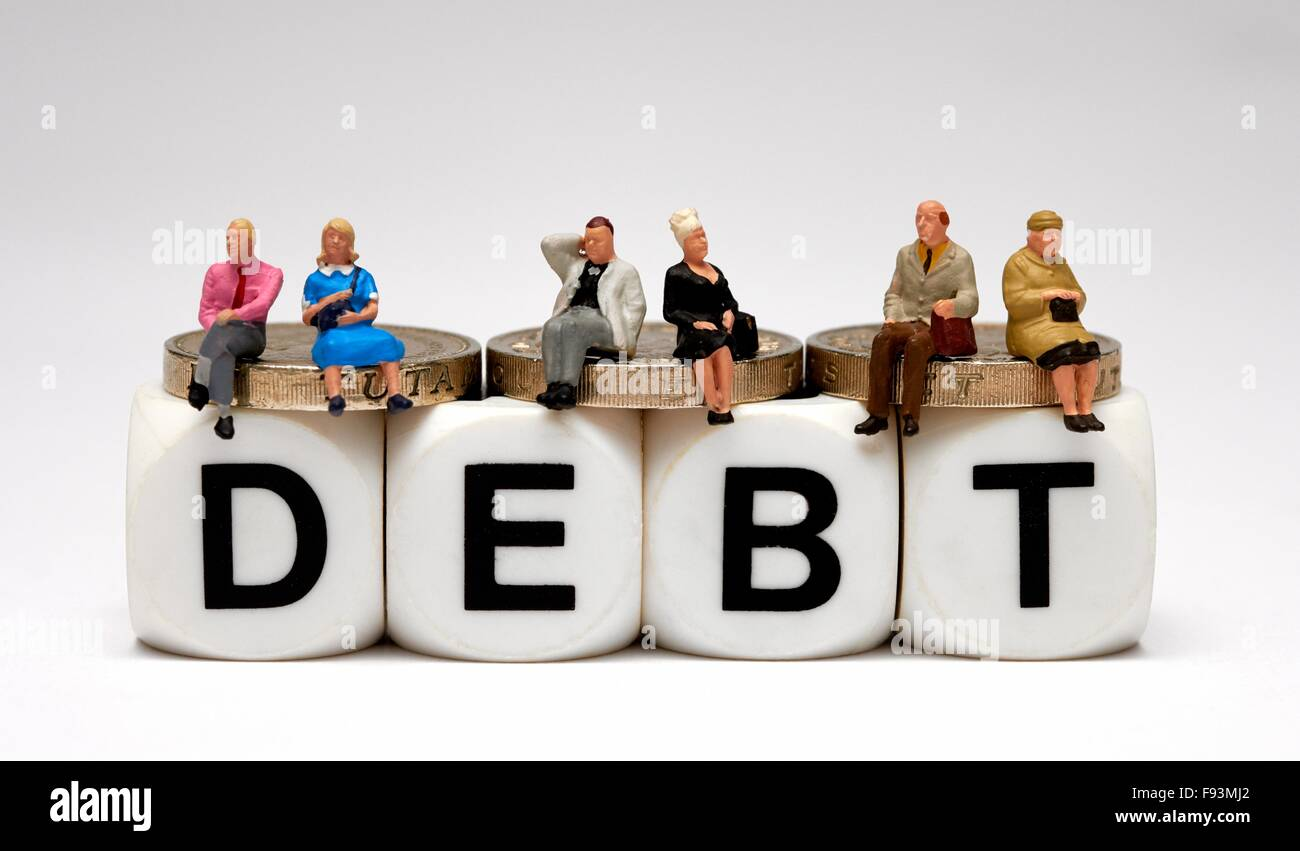 Miniature people sitting on one pound coins with the word debt below. - Stock Image