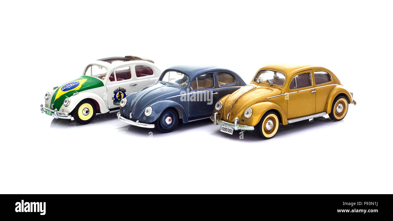 Three Vintage VW Beetles  Die cast models on a white background. - Stock Image