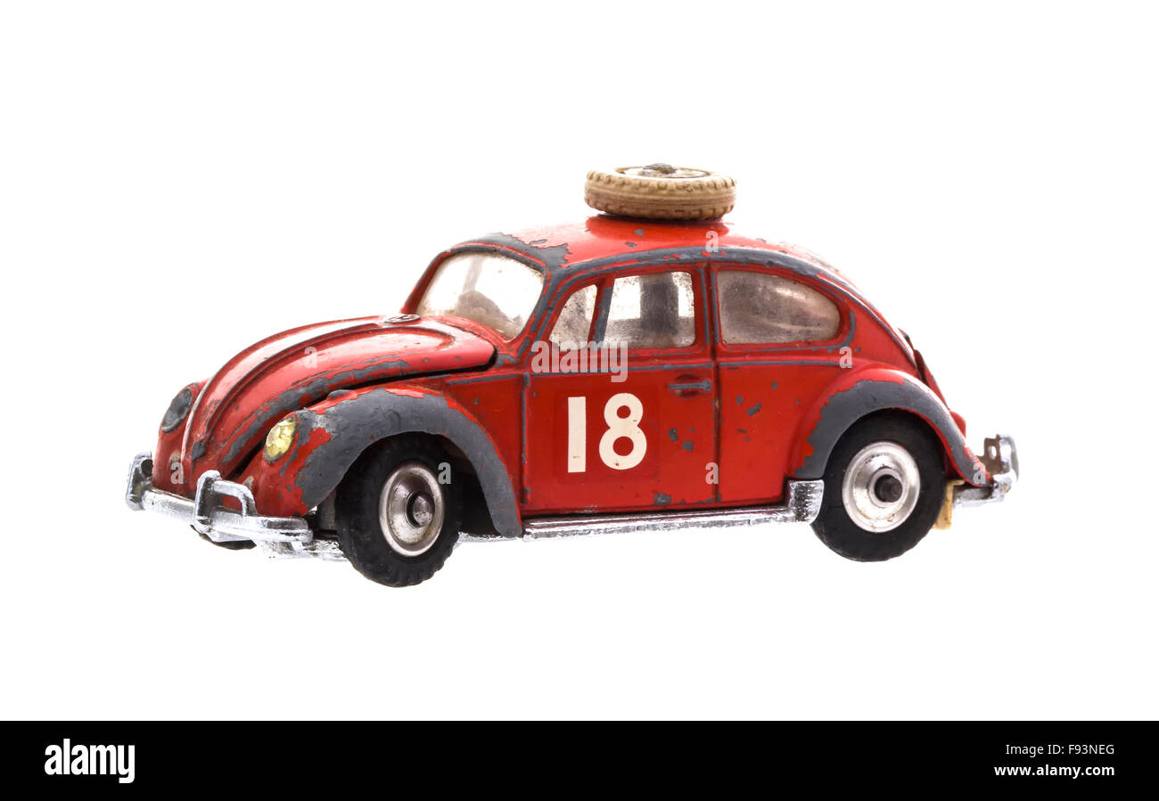 Old Well Worn Red VW Beetle Trim  Die cast model on a white background. - Stock Image