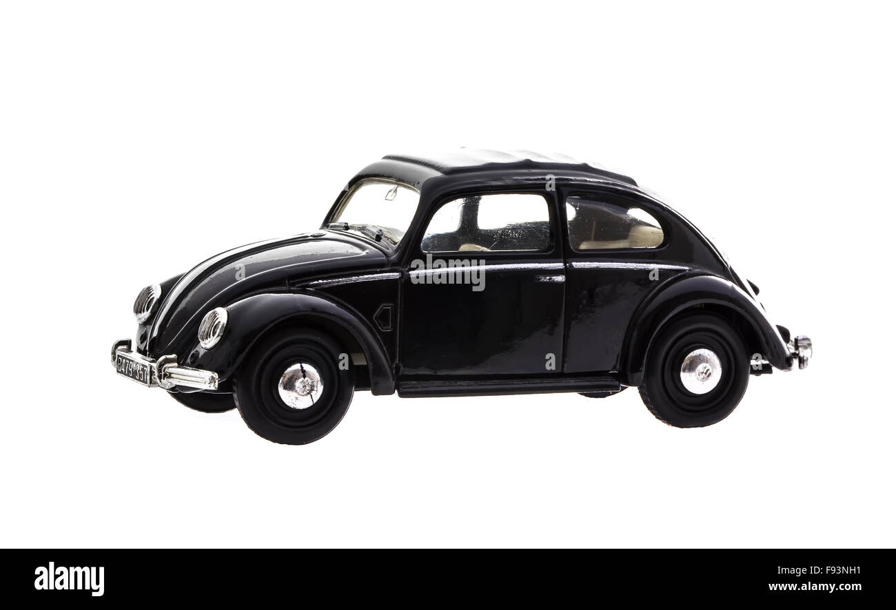 VW Beetle in Black Die cast model on a white background. - Stock Image
