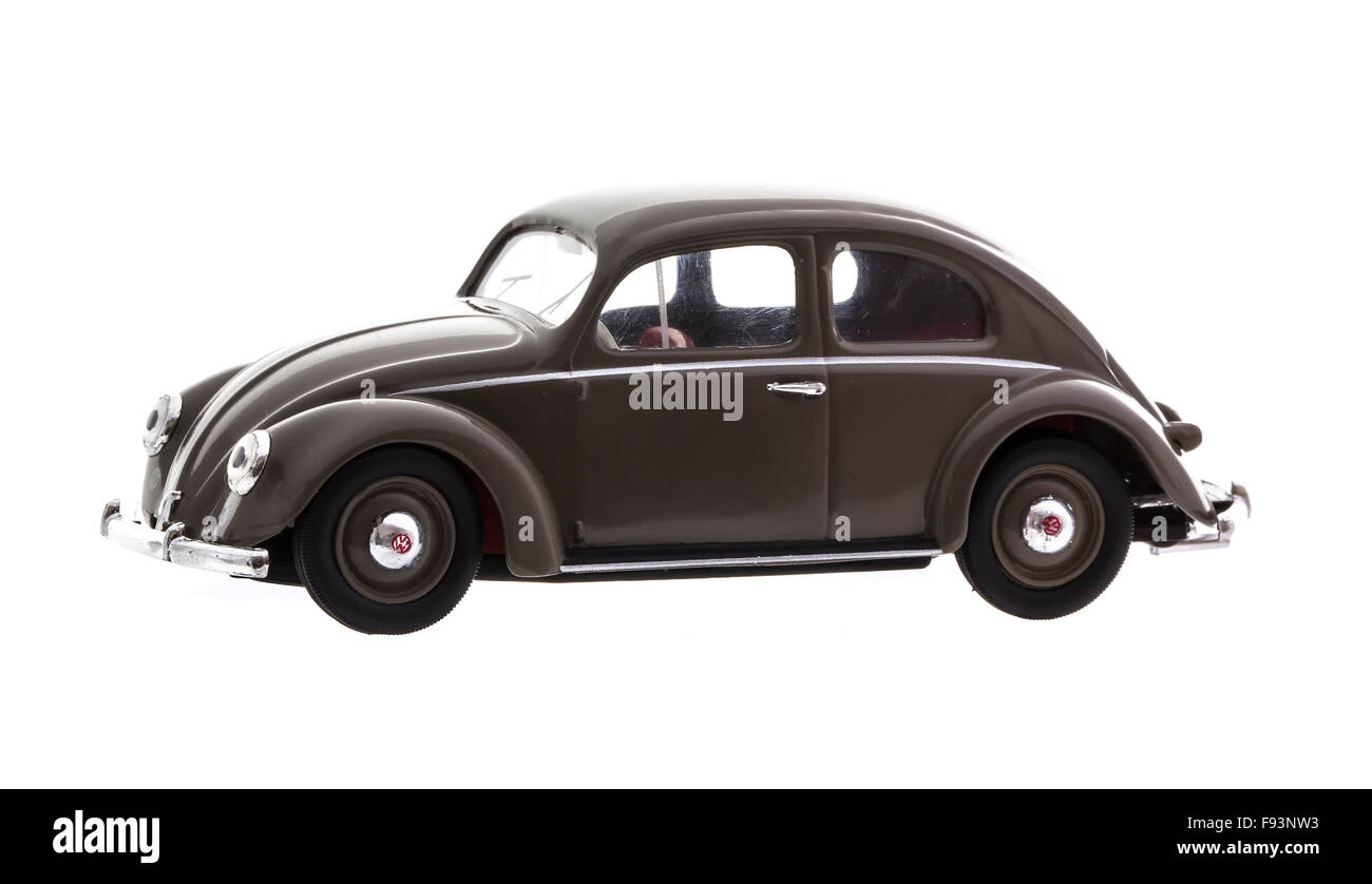 VW Beetle in Brown Die cast model on a white background. - Stock Image