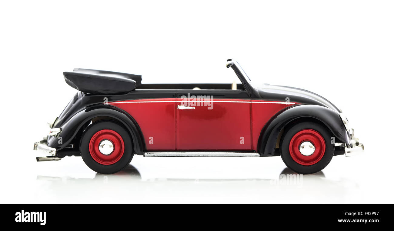 Convertible Vw Beetle In Red And Black Die Cast Model On A White Stock Photo Alamy