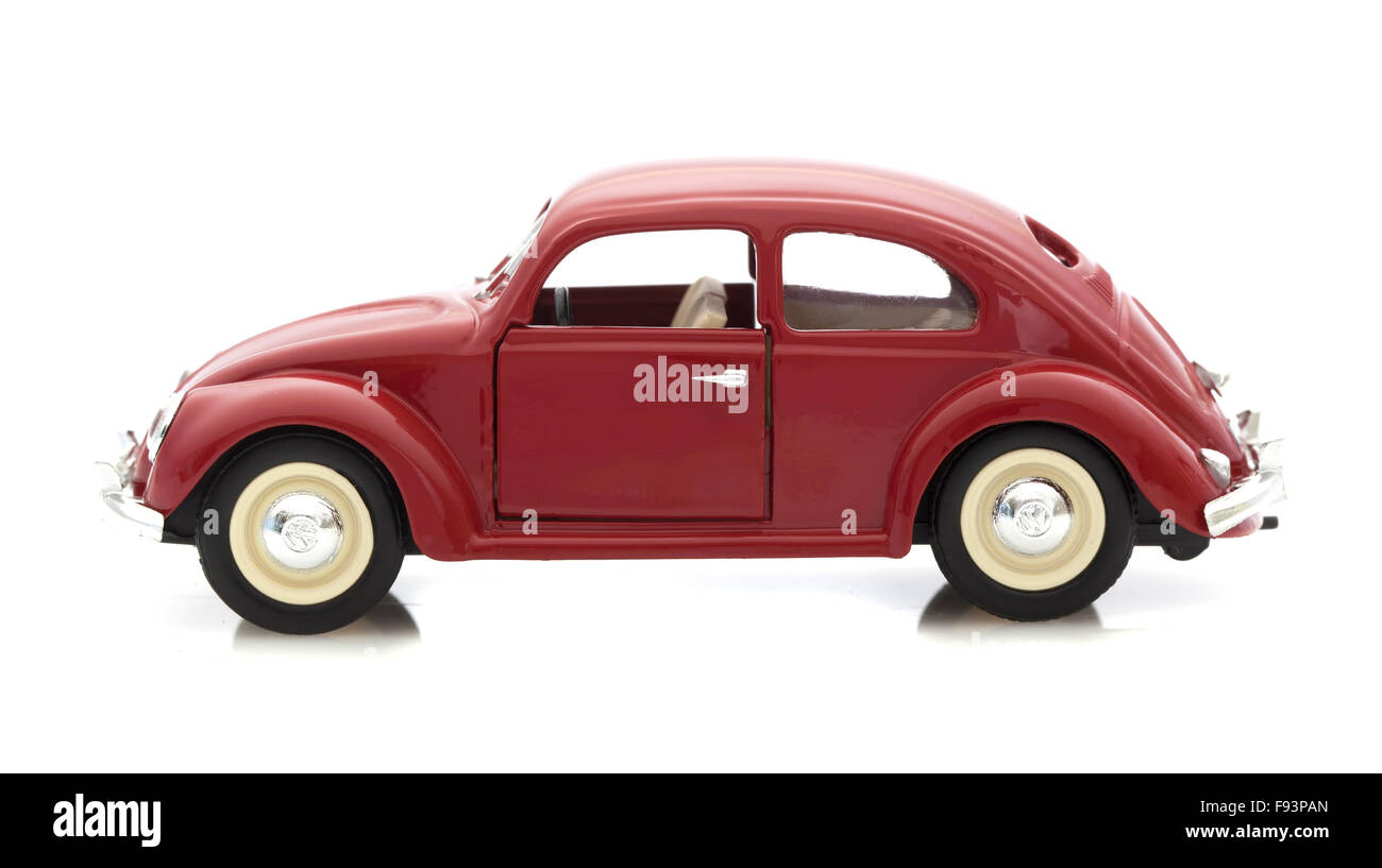 VW Beetle in Red, Die cast model on a white background. - Stock Image