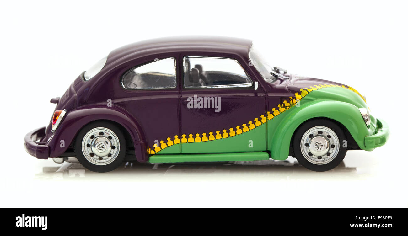 VW Beetle With Zip Paint Die cast model on a white background. - Stock Image