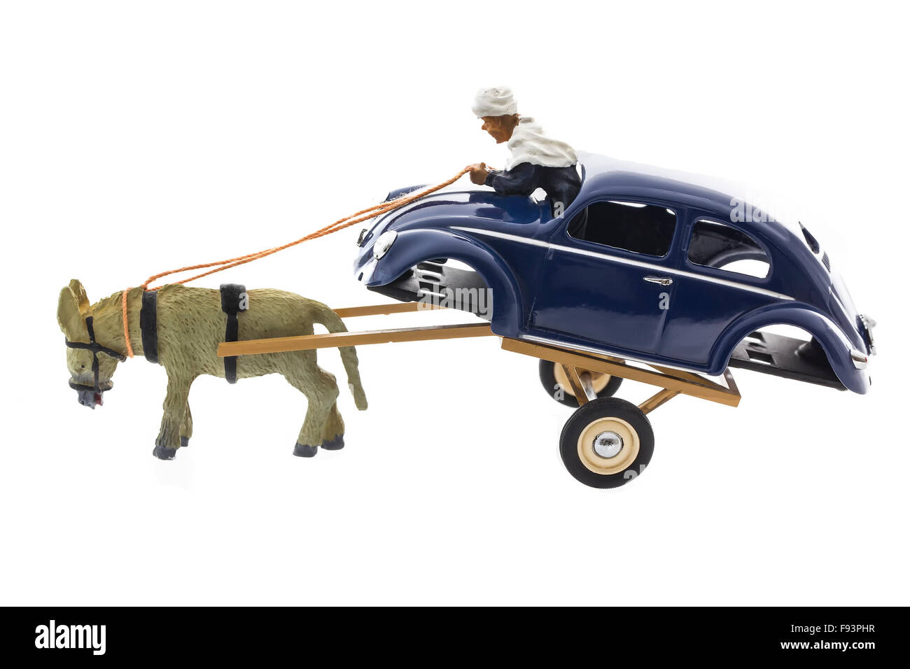 VW body on a trailer pulled by a Donkey Die cast model on a white background. - Stock Image