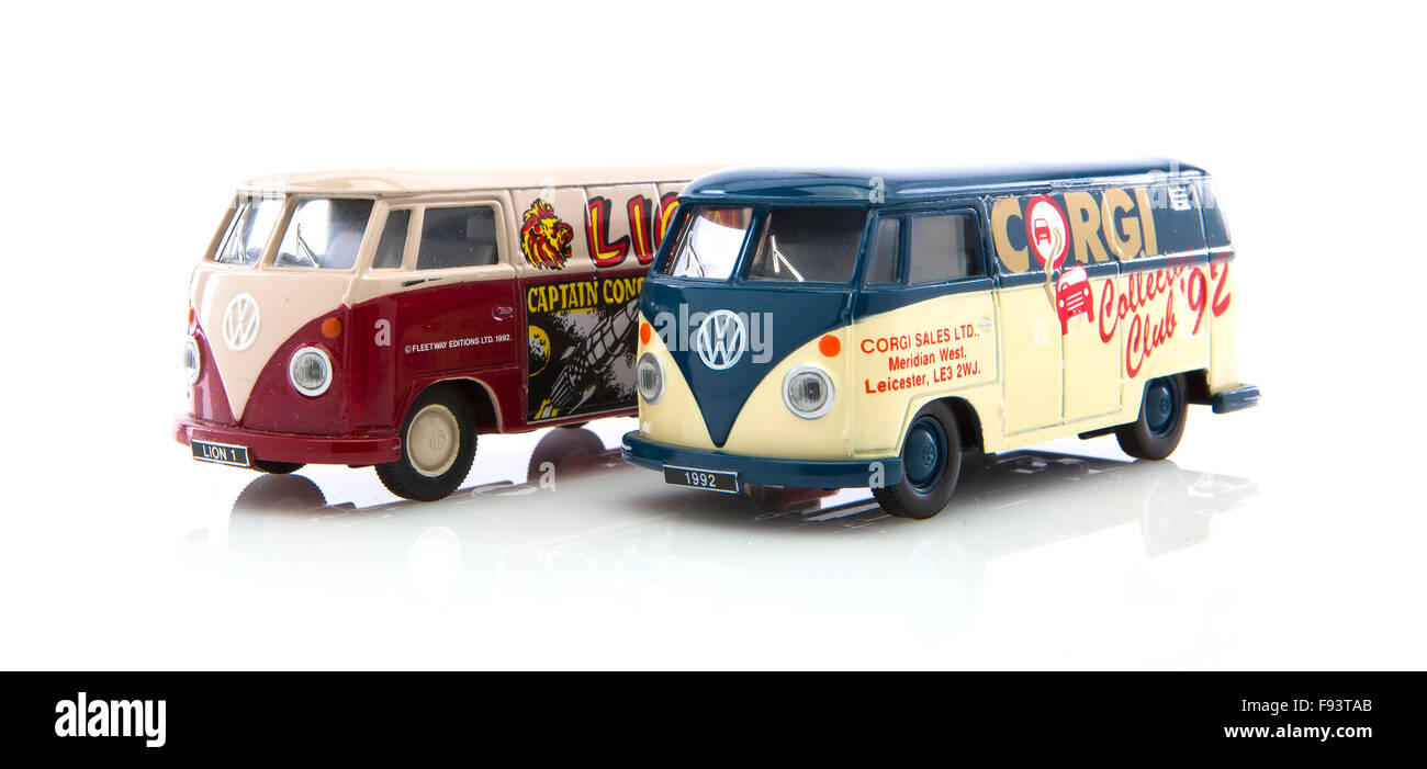 Two Old VW Vans Made By Corgi on a White Background - Stock Image