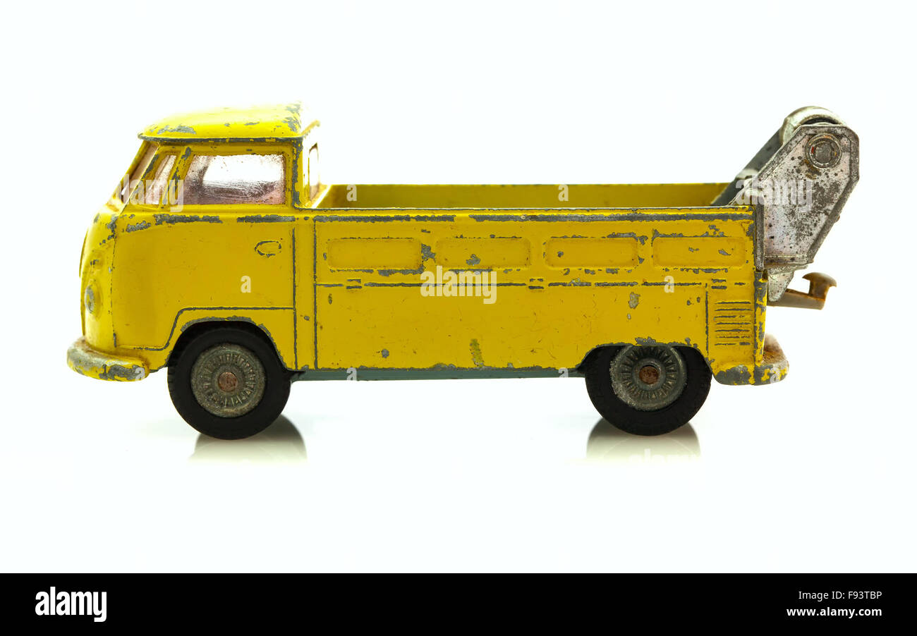 Old Well Worn Yellow VW Breakdown truck - 490 By Corgi Die Cast Model on a white Background - Stock Image