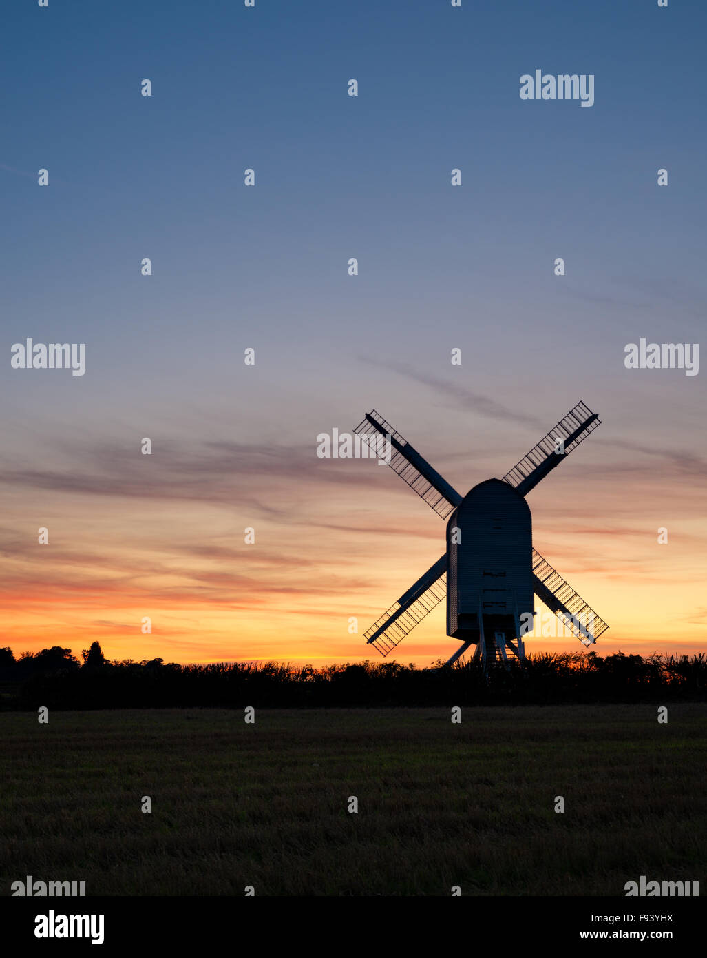 Chillenden Windmill in the Kent countryside, silhouetted at sunset. - Stock Image